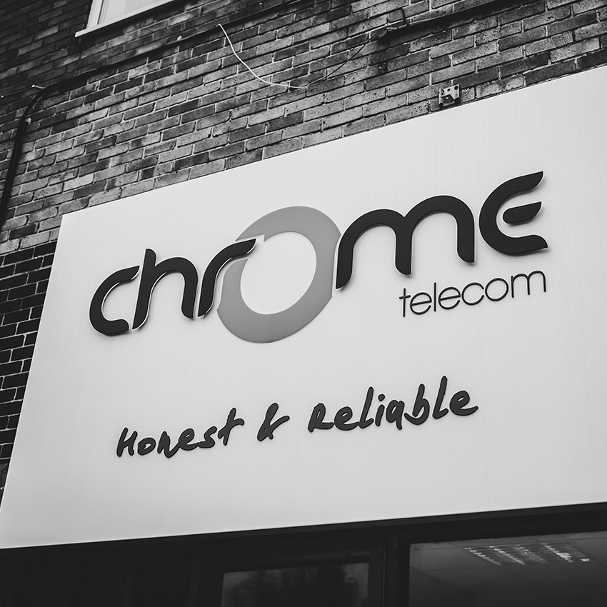 close up of the chrome external wall logo